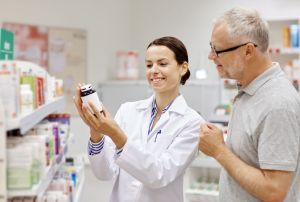 pharmacist showing smart drug to man